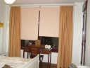 CORTINAS CON ENROLLABLES EN COLOR SALMON